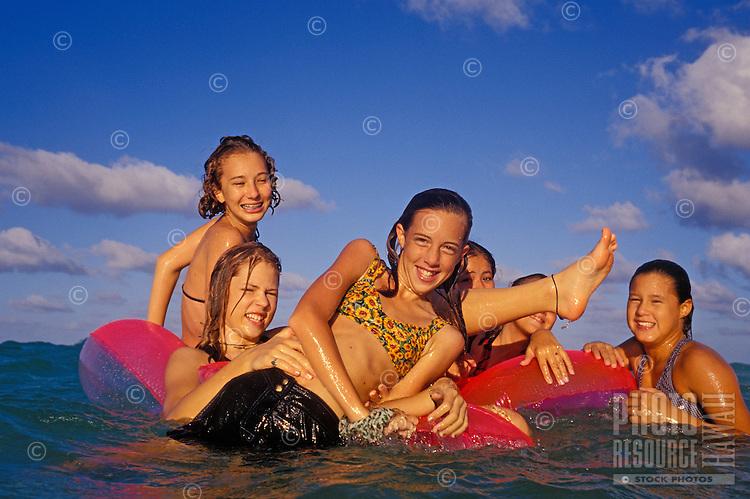 Teenage girls playing in the ocean