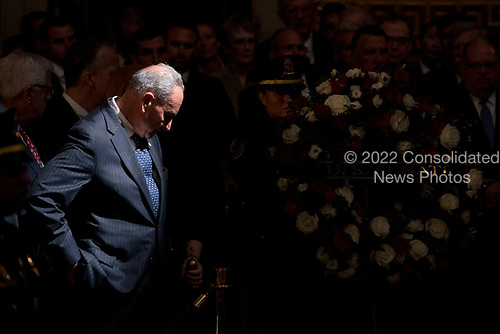 Senate Minority Leader Sen. Chuck Schumer of N.Y. watches as a wreath is brought in to be placed at the casket of Sen. John McCain, R-Ariz., as he lies in state in the Rotunda of the U.S. Capitol, Friday, Aug. 31, 2018, in Washington. (AP Photo/Andrew Harnik, Pool)