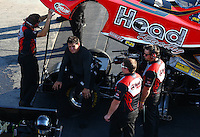 Aug 15, 2014; Brainerd, MN, USA; NHRA funny car driver Chad Head (center) with crew during qualifying for the Lucas Oil Nationals at Brainerd International Raceway. Mandatory Credit: Mark J. Rebilas-USA TODAY Sports