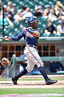 Gwinnett Braves right fielder Mel Rojas Jr. (24) swings at a pitch during a game against the Charlotte Knights at BB&T Ballpark on May 7, 2017 in Charlotte, North Carolina. The Knights defeated the Braves 7-1. (Tony Farlow/Four Seam Images)
