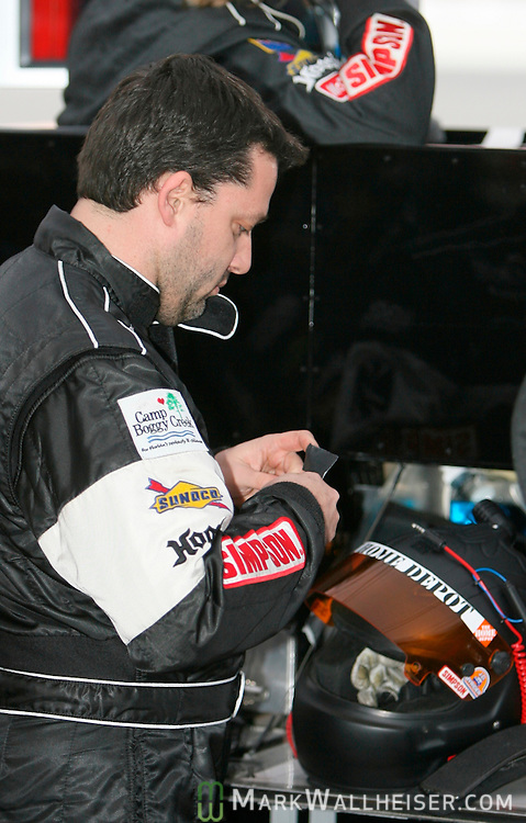 NASCAR driver Tony Stewart fixes his helmet prior to getting into the the Pontiac Crawford of Howard Motorsports for his turn in the Rolex 24 at Daytona at Daytona International Speedway in Daytona, Florida Saturday January 27, 2007.  (Mark Wallheiser/TallahasseeStock.com)