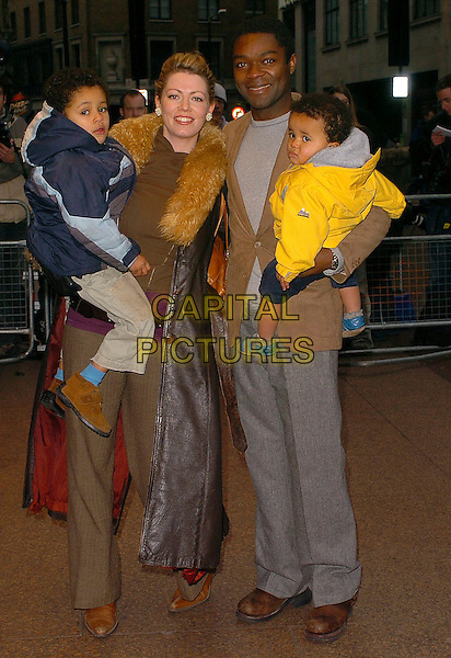 DANIEL OYELOWO & FAMILY.It's A Boy! UK Premiere held at Odeon Cinema, Leicester Square. London..UK. United Kingdom..27th November 2005.Ref: CAN.full length with together family wife husband father dad holding carrying children smiling.www.capitalpictures.com.sales@capitalpictures.com.©Capital Pictures