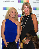 Carole King and former United States Ambassador to Portugal Elizabeth Bagley arrive for the formal Artist's Dinner honoring the recipients of the 38th Annual Kennedy Center Honors hosted by United States Secretary of State John F. Kerry at the U.S. Department of State in Washington, D.C. on Saturday, December 5, 2015. The 2015 honorees are: singer-songwriter Carole King, filmmaker George Lucas, actress and singer Rita Moreno, conductor Seiji Ozawa, and actress and Broadway star Cicely Tyson.<br /> Credit: Ron Sachs / Pool via CNP