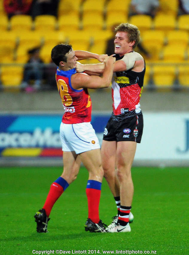 Lewis Taylor (left) and Jack Newnes get to know each other during the ANZAC Day AFL match between St Kilda Saints and Brisbane Lions at Westpac Stadium, Wellington, New Zealand on Friday, 25 April 2014. Photo: Dave Lintott / lintottphoto.co.nz