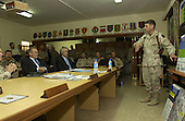 United States Secretary of Defense Donald H. Rumsfeld (left) receives a briefing from the Commander of the 1st Infantry Division Major General John F. Batiste, United States Army, in Kirkuk, Iraq, on October 10, 2004.  Rumsfeld is in Iraq to meet and show support for the coalition troops and meet with Iraqi officials.  <br /> Mandatory Credit: James M. Bowman / DoD via CNP