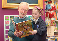 "*** NO FEE PIC***.01/03/2012.Pictured is Irish Author Brendan O' Brien with third class pupil Alison McGovern (8) from Holy Cross National School Dundrum, Dublin at a free reading event of his book "" The Story of Ireland"" in Eason Dundrum to celebrate the 15th annual World Book Day. To celebrate World Book Day Eason, Ireland's leading retailerof books, stationery, magazines & More have teamed up with some of Ireland'sleading children's writers to deliver a series of events in key stores to mark World Book Day..Photo: Gareth Chaney Collins"