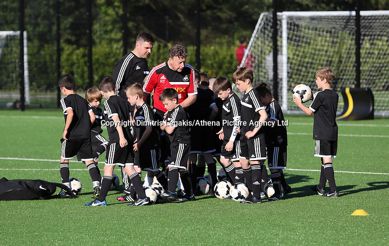 Pictured: Wednesday 14 May 2014<br /> Re: Swansea City FC academy has invited local football coaches to show them coaching techniques at the club's Landore training ground.