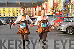 Jingle Bell Run : Miss Universe Ireland Aoife Hannon and Mary O' Brien approaching the finishing line after competing in the Kerry Crusaders annual Jingle Bell run in Listowel on Sunday last.