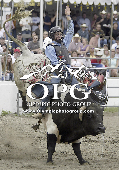 29 Aug 2004: Bull Rider Jarrod Ford 18th ranked in the world rides the bull Spin Drift during the PRCA 2004 Extreme Bulls competition in Bremerton, WA.