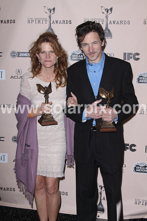 **ALL ROUND PICTURES FROM SOLARPIX.COM**                                             **SYNDICATION RIGHTS FOR UK, AUSTRALIA, DENMARK, PORTUGAL, S. AFRICA, SPAIN & DUBAI (U.A.E) & ASIA (EXCLUDING JAPAN) ONLY**                                                                                  Caption:  2011 Film Independent Spirit Awards held at  Santa Monica Beach  CA, USA                                                                              This pic: Dale Dickey and John Hawkes                                                                                            JOB REF:12898        PHZ       DATE:26.02.2011                                                            **MUST CREDIT SOLARPIX.COM OR DOUBLE FEE WILL BE CHARGED**                                                                      **MUST AGREE FEE BEFORE ONLINE USAGE**                               **CALL US ON: +34 952 811 768 or LOW RATE FROM UK 0844 617 7637**