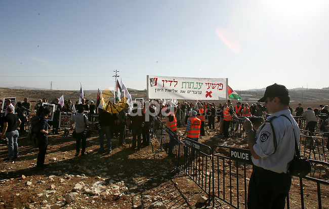 Israeli soldiers stand guard as Palestinian demonstrators take part in a protest in the mostly Arab Jerusalem neighbourhood of Enata on Nov.11,2011. Photo by Mahfouz Abu Turk