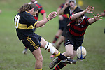 Bombay firstfive Q. Capewell clears for touch under pressure. Counties Manukau Premier 2 Championship game between Bombay and Papakura played at Bombay on May 13th, 2006. Papakura won 8 - 7.