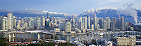 Vancouver City Skyline and Downtown at Yaletown and False Creek, BC, British Columbia, Canada, Winter - North Shore Mountains (Coast Mountains) rise above City, Panoramic View