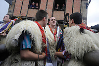 "A group of ""Joaldun""  attend the carnival carrying sheep furs and big cowbells on their backs on January 27, 2014 at the village of Ituren, Basque Country. Joaldun groups perform an ancient traditional carnival at the villages of Ituren and Zubieta during two days, carrying sheep furs and big cowbells in their backs and making sound them in order to wake up the earth, to ask for a good new year, a good harvest and also to keep away the bad spirits. (Ander Gillenea / Bostok Photo)"