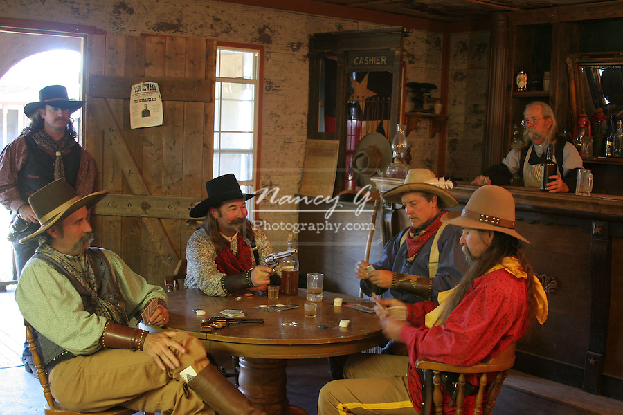 Old Western Town Saloon bar Poker card game is not going this cowboys way