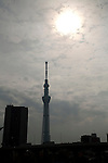 Skies darken behind Tokyo Sky Tree as the moon passes in front of the sun during an annular solar eclipse over the skies of Tokyo, Japan on Monday May 21st, 2012. This was the first time in 173 years that an annualar solar eclipse was visible from Tokyo.