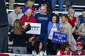 Supporters gather for a picture prior to a Make America Great Again campaign rally at Atlantic Aviation in Moon Township, Pennsylvania on March 10th, 2018. Credit: Alex Edelman / CNP