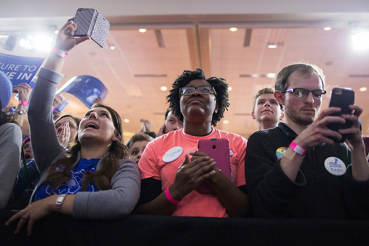 UNITED STATES - FEB 1. - Supporters watch Democratic presidential candidate Sen. Bernie Sanders, I-Vt., speak at his caucus night rally at the Holiday Inn Des Moines Airport and Conference Center, on Monday, Feb. 1, 2016 in Des Moines, Iowa. (Photo By Al Drago/CQ Roll Call)
