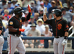 San Francisco Giants' Denard Span is greeted at the plate after hitting a two-run homer in a spring training game against the Milwaukee Brewers in Phoenix, AZ, on Thursday, March 23, 2017.<br /> Photo by Cathleen Allison/Nevada Photo Source