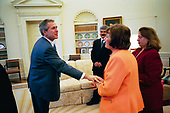 United States President George W. Bush says good bye to Dr. Katrin Michael, foreground, Della Jaff and Idres Hawarry in the Oval Office Friday, March 14, 2003, after speaking with them. The three are from the Kurdish area of Iraq where a chemical weapons attack killed 5,000 citizens 15 years ago this weekend. Thousands died in the days following the attack on Halabja and an estimated 10,000 people still suffer from the attack. Idres Hawarry survived the attack on Halabja, Dr. Michael survived a similar attack in another Kurdish village and friends and family of Della Jaff were killed in Halabja.<br /> Mandatory Credit: Eric Draper / White House via CNP