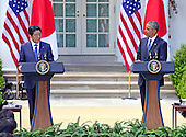 United States President Barack Obama, right, and Prime Minister Shinzo Abe of Japan, left, conduct a joint press conference in the Rose Garden of the White House in Washington, D.C. on Tuesday, April 28, 2015.<br /> Credit: Ron Sachs / CNP