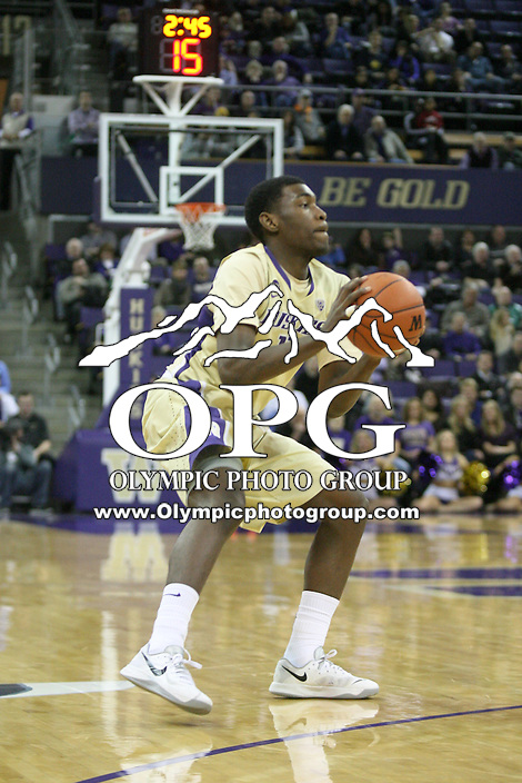 February 12, 2014:   Washington's Mike Anderson against Stanford.  Washington defeated Stanford 64-60 at Alaska Airlines Arena in Seattle, Washington.
