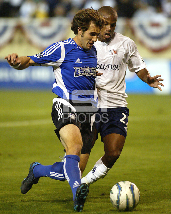 San Jose Earthquakes midfielder Brian Mullan and New England Revolution defender Marshall Leonard battle for a loose ball during their teams' 2005 MLS match on April 2, 2005 at Spartan Stadium in San Jose, California.  The match ended in a 2-2 tie.