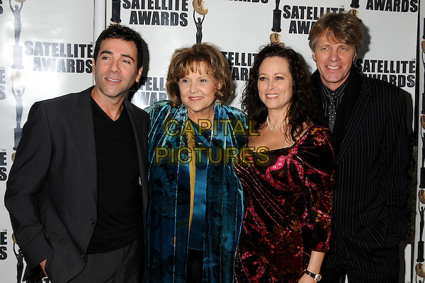 STEVE LEE JONES, BRENDA VACCARO, MICHELLE JONES & GUY HECTOR .15th Annual Satellite Awards presented by the International Press Academy held at the InterContinental Hotel, Century City, California, USA, .19th December 2010..half length grey gray jacket blue teal velvet red  dress  .CAP/ADM/BP.©Byron Purvis/AdMedia/Capital Pictures.