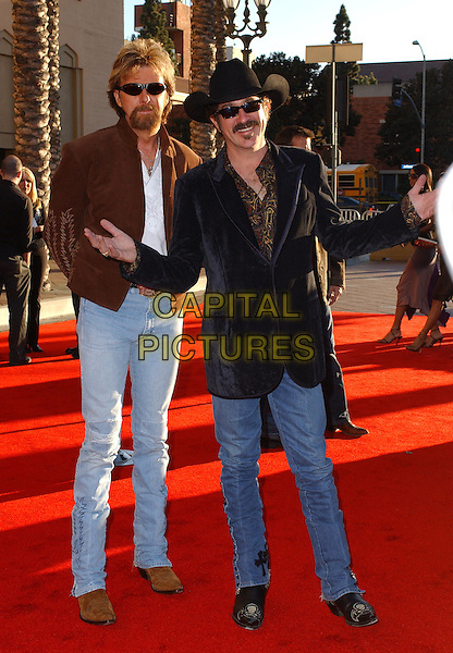 BROOKS & DUNN.The 33rd Annual American Music Awards held at The Shrine Auditorium in Los Angeles, California.  .November 22nd, 2005.Ref: DVS.AMA's full length jeans denim sunglasses shades hat stetson black jacket arms .www.capitalpictures.com.sales@capitalpictures.com.Supplied By Capital PIctures