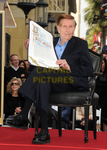 Sumner Redstone is honored with a Star on The Hollywood Walk Of Fame held in front of the Hollywood Roosevelt Hotel, Hollywood, California, USA, .30th March 2012..full length sitting down chair black blue shirt navy .CAP/ADM/BP.©Byron Purvis/AdMedia/Capital Pictures.