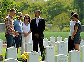 United States President Barack Obama and First Lady Michelle Obama visit Section 60 at Arlington National Cemetery, on Saturday, September 10, 2011, in Arlington, Virginia.  This section contains military personnel who were killed in the Iraq and Afghanistan wars since 9/11. .Credit: Leslie E. Kossoff / Pool via CNP