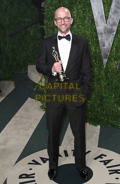 Jim Rach.2012 Vanity Fair Oscar Party held at the Sunset Tower West Hollywood, California, USA..26 February 2012.oscars full length black tuxedo award trophy glasses  winner stubble facial hair .CAP/ADM/FS.©Faye Sadou/AdMedia/Capital Pictures.