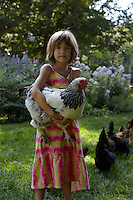 Alice is in charge of the hens as they forage for food around the garden