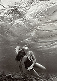 AURBA, Palm Island, young woman swimming in sea (B&W)