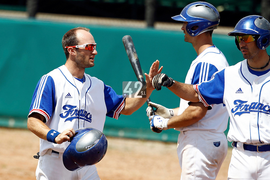 23 June 2011: Joris Bert of Team France is congratulated by his teammates during USSSA 5-3 win over France, at the 2011 Prague Baseball Week, in Prague, Czech Republic.