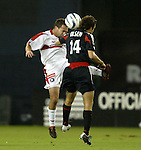 18 September 2004: Scott Buete (left) and Ben Olsen (14) challenge for a header in the first half. DC United defeated the Chicago Fire 3-1 at RFK Stadium in Washington, DC in a regular season Major League Soccer game..