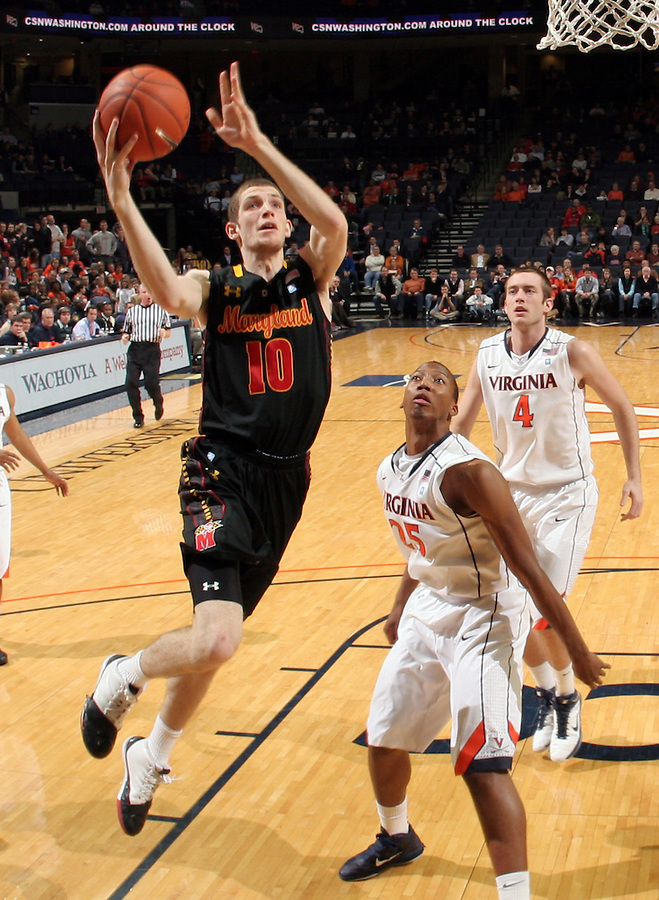 Jan. 27, 2011; Charlottesville, VA, USA; Maryland Terrapins center Berend Weijs (10) drives to the basket in front of Virginia Cavaliers forward Akil Mitchell (25) and Virginia Cavaliers forward Will Regan (4) during the game at the John Paul Jones Arena. Maryland won 66-42. Mandatory Credit: Andrew Shurtleff