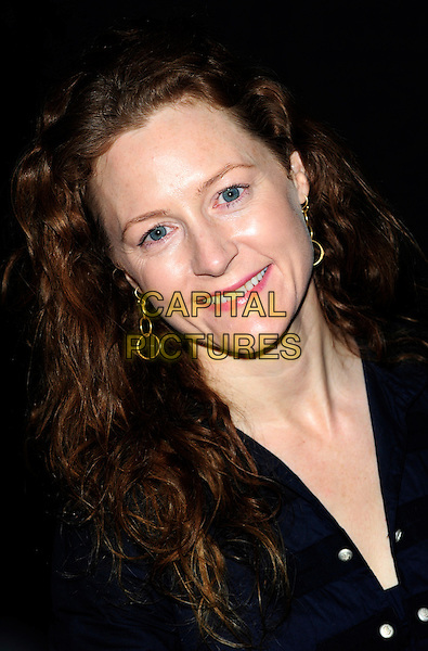 GERALDINE SOMERVILLE .Attending the film premiere of 'Bob the Builder: The Legend of the Golden Hammer' at Vue West End cinema, Leicester Square, London, England, .May 15th 2010..arrivals portrait headshot smiling navy blue .CAP/CJ.©Chris Joseph/Capital Pictures.