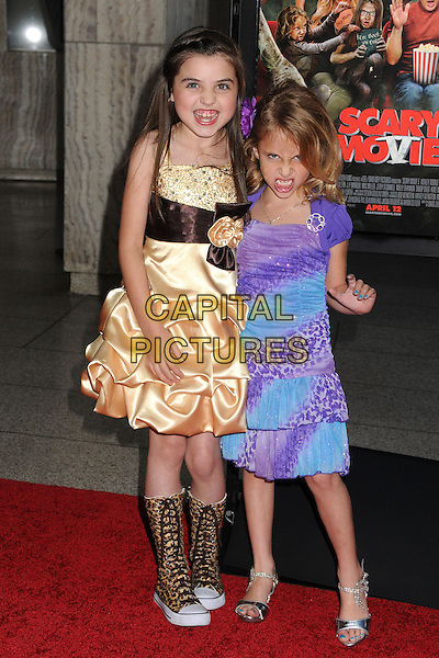 "Gracie Whitton, Ava Kolker.Attending the ""Scary Movie 5"" Los Angeles film premiere held at the Cinerama Dome,  Hollywood, California, USA, .11th April 2013..full length purple blue print dress  gold knee high animal print trainers .CAP/ADM/BP.©Byron Purvis/AdMedia/Capital Pictures"