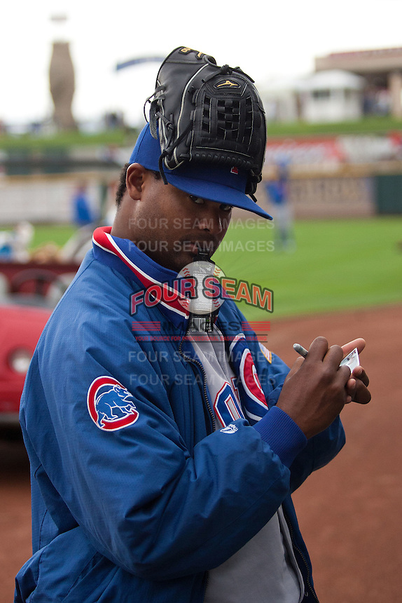 Iowa Cubs pitcher Manny Corpus #50 signs an autograph before the Pacific Coast League baseball game against the Round Rock Express on April 15, 2012 at the Dell Diamond in Round Rock, Texas. The Express beat the Cubs 11-10 in 13 innings. (Andrew Woolley / Four Seam Images).