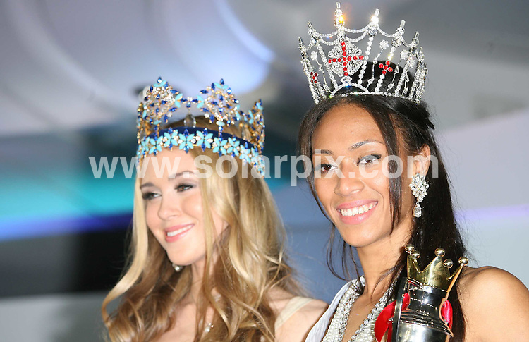 **ALL ROUND PICTURES FROM SOLARPIX.COM**.**WORLDWIDE SYNDICATION RIGHTS**.the 2009 Miss England Contest held at the London Hilton Metropole Hotel, which showcased 54 finalists. London, UK.  20 July 2009..This pic: Last years Miss World Kseniya Sukhinova of Russia celebrates with Rachel Christy..JOB REF: 9539 LNJ     DATE: 20_07_2009.**MUST CREDIT SOLARPIX.COM OR DOUBLE FEE WILL BE CHARGED**.**ONLINE USAGE FEE GBP 50.00 PER PICTURE - NOTIFICATION OF USAGE TO PHOTO @ SOLARPIX.COM**.**CALL SOLARPIX : +34 952 811 768 or LOW RATE FROM UK 0844 617 7637**
