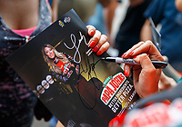 Apr 22, 2017; Baytown, TX, USA; NHRA top fuel driver Leah Pritchett signs autographs during qualifying for the Springnationals at Royal Purple Raceway. Mandatory Credit: Mark J. Rebilas-USA TODAY Sports
