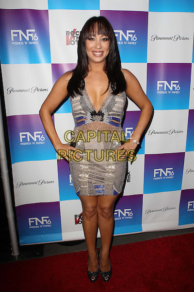 Cheryl Burke.Paramount Studios' 16th Annual Friends 'N' Family Party Held At Paramount Studios, Los Angeles, California,.USA, 8th February 2013..full length hands on hips purple white grey gray silver dress low cut v-neck cleavage .CAP/ADM/KB.©Kevan Brooks/AdMedia/Capital Pictures.