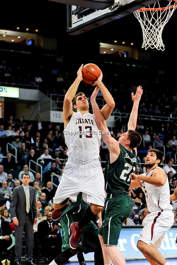 Colgate Raiders forward Murphy Burnatowski (13) and Providence Friars forward Lee Goldsbrough (21) during the NCAA basketball game between the Providence College Friars and the Colgate University Raiders at the Dunkin Donuts Center. Eric Canha/CSM