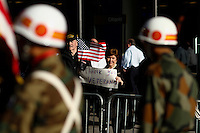 A woman holds a banner while she attends the annual Veterans Day parade in New York.  10.11.2014. Eduardo Munoz Alvarez/VIEWpress