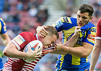 Picture by Allan McKenzie/SWpix.com - 13/07/2017 - Rugby League - Betfred Super League - Wigan Warriors v Warrington Wolves - DW Stadium, Wigan, England - WIgan's Joe Burgess fends off Warrington's Declan Patton.