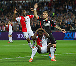 Elvis Manu of Feyenoord (C) reacts after he failed to score as Martin Milec of Standad Luik (R) and teammate Terence Kongolo react during their Europa League soccer match in Rotterdam October 2, 2014. REUTERS/Michael Kooren (NETHERLANDS)