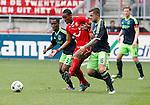 Nederland, Enschede, 29 april 2012.Eredivisie.Seizoen 2011-2012.FC Twente-Ajax.Theo Janssen (r.) van Ajax en Vurnon Anita (l.) van Ajax duelleren met Leroy Fer (m.) van FC Twente