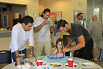 General Hospital Erik Valdez and Days Eric Martsolf paint with Marlowe, daughter of Thorsten and Susan and they donate time at SoapFest's Celebrity Weekend - Art for Autism when the actors & kids make paintings for auction to benefit Autism on November 10, 2012 Marco Island, Florida. For info www.autism-society.org or www.autismspeaks.org. (Photo by Sue Coflin/Max Photos)