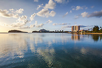 Lagoon Reflection.  Some of the bays and lagoons around Guam are very shallow for hundreds of yards into the sea.  Here in the calm shallow water of the lagoon the towering hotels and clouds cast a nice reflection upon the water